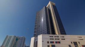 Modern new towers in Ajman timelapse hyperlapse. Cityscape of Ajman. AJMAN, UAE - SEPTEMBER 2016: Modern new towers in Ajman timelapse hyperlapse. Cityscape of stock image