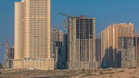 Modern new towers construction in Ajman timelapse. Cityscape of Ajman. Ajman is the capital of the emirate of Ajman in the United Arab Emirates. 4K royalty free stock photo