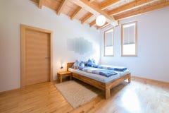 Modern new wooden bedroom Stock Images