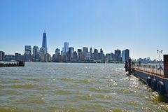 Modern New York City Viewed from Liberty State Park across Hudson River on a sunny day Royalty Free Stock Images