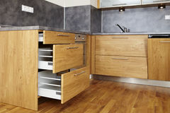 Opened drawers. Modern and nice design kitchen interior in contemporary city building stock images