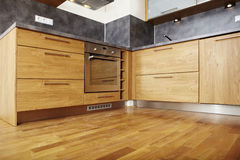 Modern wooden. Modern and nice design kitchen interior in contemporary city building royalty free stock photos