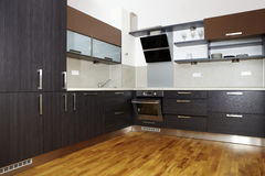 Modern kitchen. Modern and nice design kitchen interior in contemporary city building royalty free stock photos