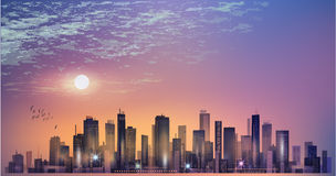 Modern night city panorama in moonlight or sunset and cloudy sky. Modern night city panorama in moonlight or sunset Stock Images