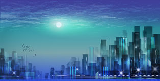 Modern night city skyline in moonlight or sunset, with cloudy sk Stock Photo