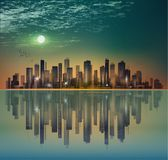 Modern night city skyline in moonlight or sunset, with reflectio Royalty Free Stock Photo