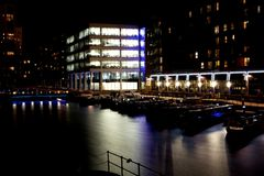 Modern northern European city at night stock image