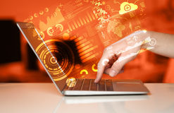 Modern notebook computer with future technology symbols Royalty Free Stock Images