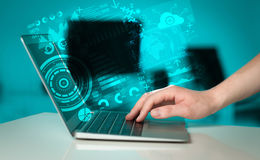 Modern notebook computer with future technology symbols Royalty Free Stock Photo