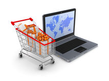 Modern notebook and shopping trolley. Royalty Free Stock Photo
