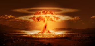 A modern nuclear bomb explosion. A modern nuclear bomb explosion over a small city or large country town Royalty Free Stock Images