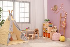 Modern nursery room interior with play tent. For kids royalty free stock photo