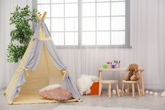 Modern nursery room interior with play tent. For kids stock photography