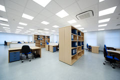 Modern office. Desks and bookcases in the modern office Stock Image