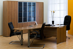 Modern office. Large wooden desk in a modern office Stock Images