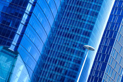 Modern office architecture at blue glass exterior wall backgroun Royalty Free Stock Image