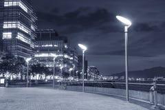 Modern office buidling. Seaside Promenade of Harbor in Hong Kong city at night Royalty Free Stock Photos