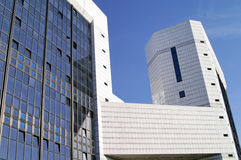 Modern office building (1). Modern sleek office building with white marble tiles in a blue sky Stock Images