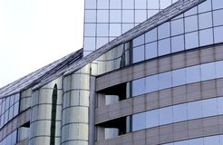 Modern office building. Office building with curved glass exterior Stock Photos
