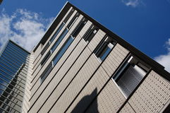 Modern office building. A modern office building with a blue sky Royalty Free Stock Images