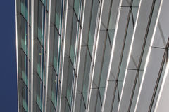 Modern office building. Windows on a modern office building making a background pattern effect Stock Photography