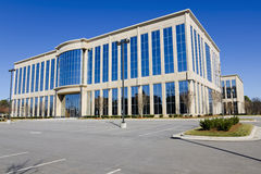Modern office building. Office building with large parking lot Stock Photo