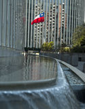 Modern office building. The Chilean flag flying outside a modern office building with a water fountain in the foreground Royalty Free Stock Image