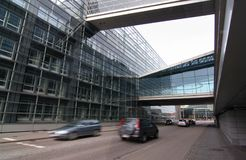 Modern Office Building. A modern office building beside road with cars passing in motion blur Royalty Free Stock Photo