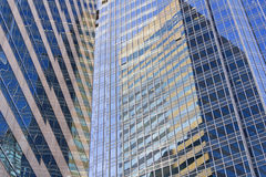 Modern office building. Glass surface of modern Commercial Buildings in Hong Kong Royalty Free Stock Image