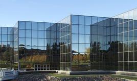 Modern Office Building. Mirrored glass windows on a modern office building Stock Image