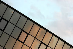 Modern office building. Angled look at modern office building under the evening light stock photography