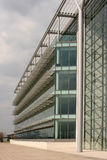 Modern office building. Modern glass building with louvered sun canopy Royalty Free Stock Photos