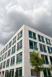 Modern Office Building. In office park with gloomy looming clouds Stock Image