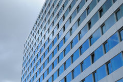 Modern office building. Office building with sky reflections in windows Royalty Free Stock Photography