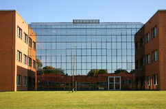 Modern Office building. Modernoffice building with a reflecting glass wall Royalty Free Stock Photography
