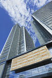 Modern office building against a blue sky with clouds, Beijing, China. Royalty Free Stock Photography