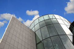 Modern office building against blue sky with clouds, low angle v Stock Image