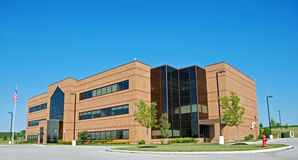 Modern Office Building. Architecture of brick and glass makes a modern looking office building Stock Images