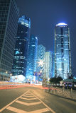 Modern office building background of car night with light trails. In Shanghai Royalty Free Stock Photos