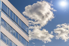 Modern office building beautiful blue sky background. Royalty Free Stock Photos