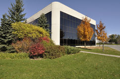 Modern Office Building with beautiful landscaping royalty free stock image