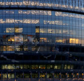 Modern office building with big windows at night Stock Image