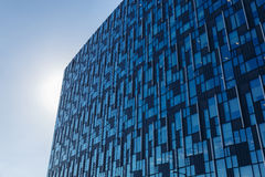 Modern office building with blue glass facade futuristic. Modern office building with blue glass facade futuristic royalty free stock photos