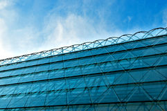 Modern office building with blue glass facade Stock Photography