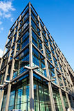 Modern office building. Modern office/business building made of glass and steel with sharp angles stock image