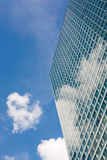 Modern office building and cloudy sky Stock Image