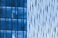 Modern office building corner, blue glass and steel. Frames stock image
