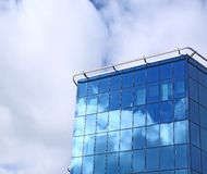 Modern office building from dark blue glass Stock Photography