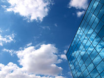 Modern office building detail. Modern building on a summer sky background royalty free stock photos