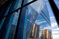 Building glass . Panoramic and perspective wide angle view to steel light blue background of glass high rise building skyscraper c royalty free stock image